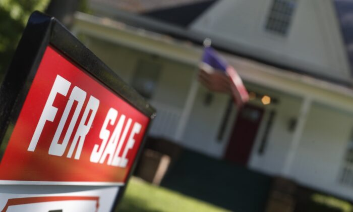 Home is offered for sale in Rutledge, Ga. On Dec. 12, Freddie Mac reports on this week's average U.S. mortgage rates. (AP Photo/John Bazemore)