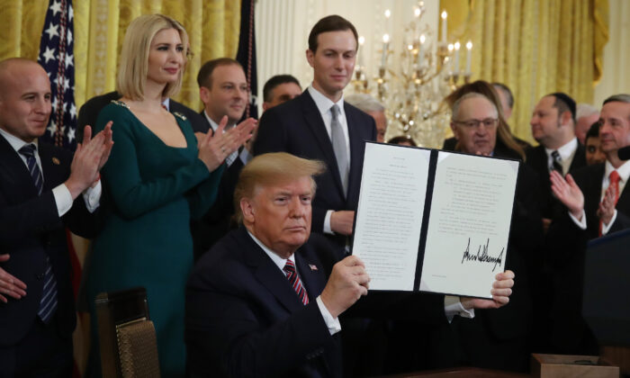 U.S. President Donald Trump signed an executive order to combat anti-Semitism during a Hanukkah Reception in the East Room of the White House on Dec. 11, 2019 in Washington, DC. (Mark Wilson/Getty Images)