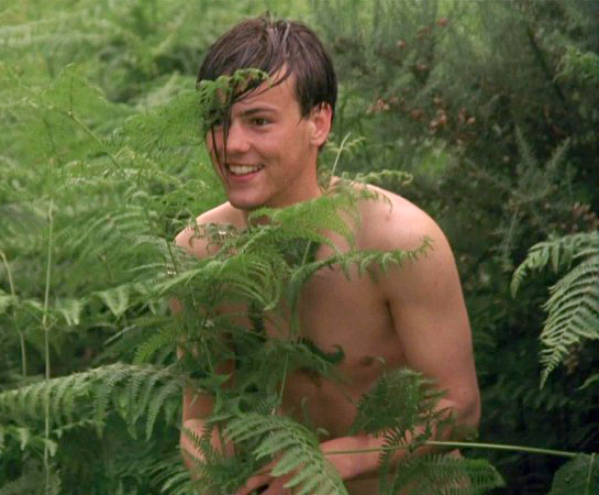 naked man in the bushes