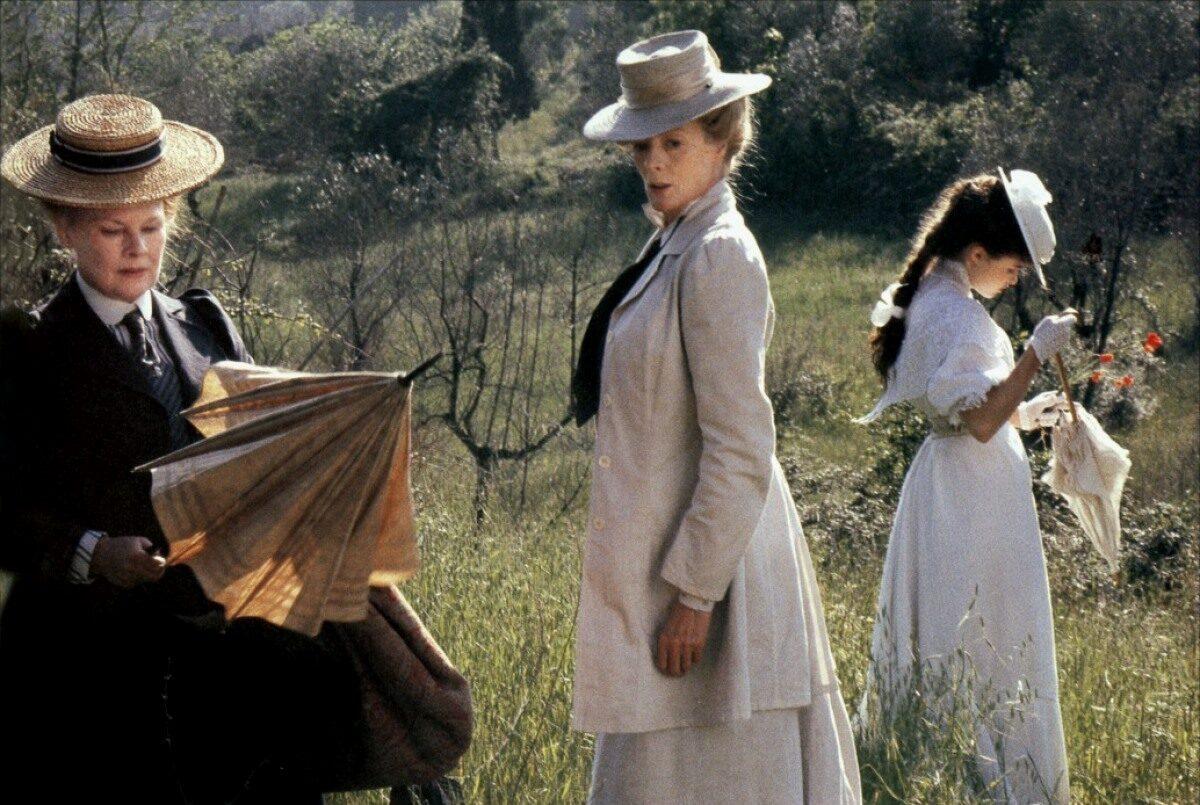 three women in victorian garb in a garden