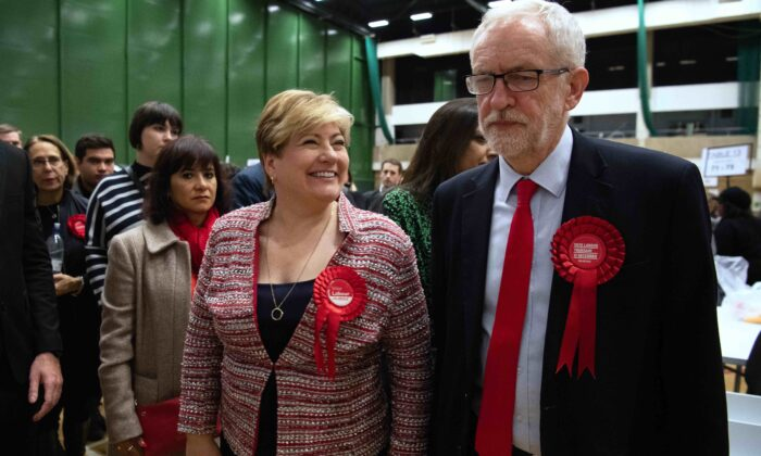 UK Labour Party leader Jeremy Corbyn (R) and Shadow Foreign Secretary Emily Thornberry meet after both retaining their Parliamentary seats following the count at Sobell leisure centre in London, England, on Dec. 13, 2019. (Leon Neal/Getty Images)