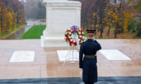 Patriotic Soldier Unfazed by Torrential Downpour Places Flag at Tomb of The Unknown Soldier