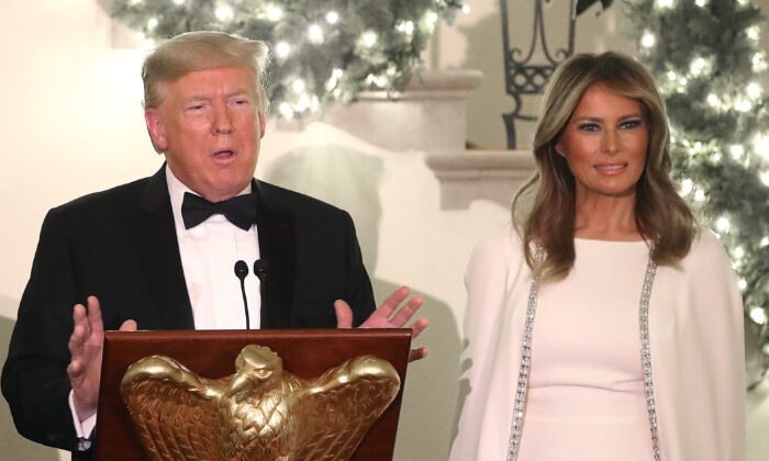 President Donald Trump speaks as First Lady Melania Trump looks on during a Congressional Ball in the Grand Foyer of the White House in Washington on Dec. 12, 2019. (Mark Wilson/Getty Images)