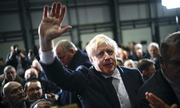 British Prime Minister Boris Johnson is applauded by supporters after speaking at the Globus Group factory in Manchester, England, on Dec. 10, 2019. (Christopher Furlong/Getty Images)