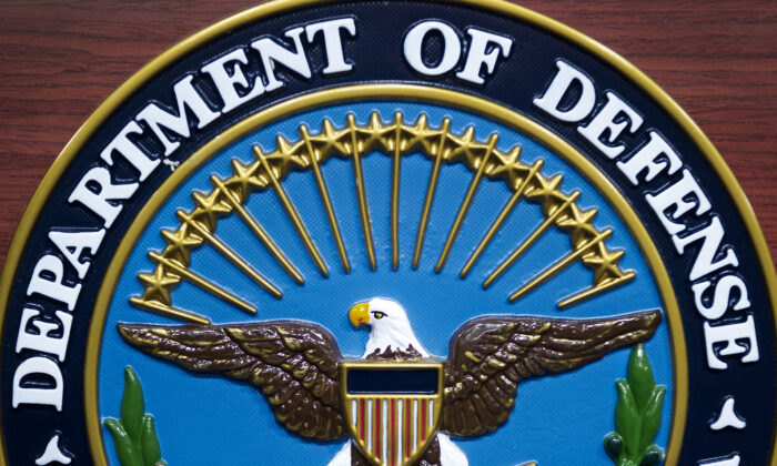 The US Department of Defense seal is seen on the lecturn in the media briefing room at the  Pentagon in Washington, on Dec. 12, 2013. (AFP Photo/Paul J. Richards/via Getty Images)