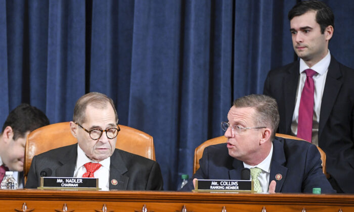 Rep. Doug Collins (R-GA) (R) voices his displeasure with  Rep. Jerry Nadler (D-NY) after Nadler abruptly delayed voting until Dec. 13 during a House Judiciary Committee markup of articles of impeachment against President Donald Trump at the Longworth House Office Building in Washington, on Dec. 12, 2019. (Jonathan Newton/Pool/Getty Images)