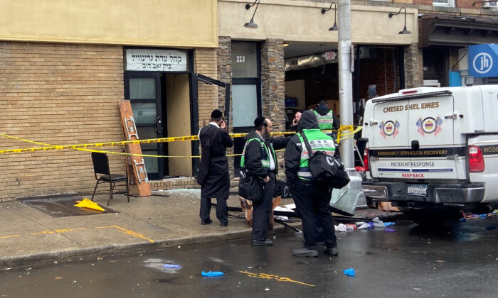 A picture of the scene the day after an hours-long gun battle with two shooters around a kosher market in Jersey City, New Jersey on Dec. 11, 2019. (Lloyd Mitchell/Reuters)