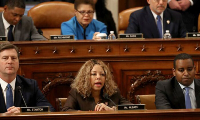 House Judiciary Committee member Rep. Lucy McBath (D-GA) (C) votes for the first of two articles of impeachment against U.S. President Donald Trump during the final moments of a hearing in the Longworth House Office Building on Capitol Hill in Washington, on Dec. 13, 2019. (Photo by Chip Somodevilla/Getty Images)