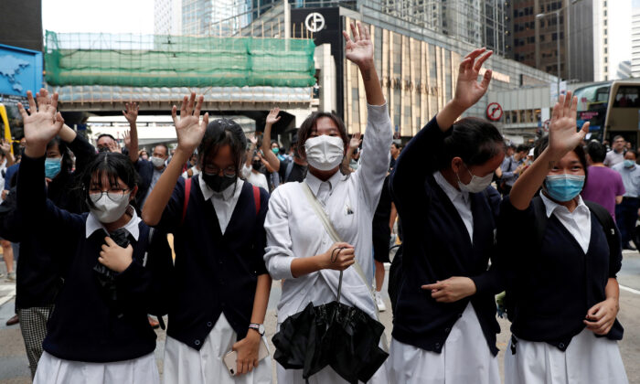 Demonstrators wear face masks during a pro-democracy protest in Central, Hong Kong, China on Nov. 12, 2019. (Shannon Stapleton/Reuters)
