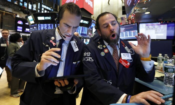 Trader Gregory Rowe (L) and specialist Michael Pistillo work on the floor of the New York Stock Exchange on Dec. 5, 2019. (Richard Drew/AP Photo)