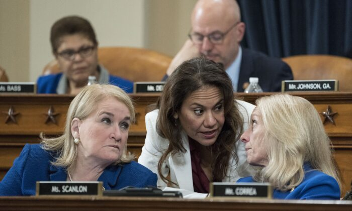 Rep. Veronica Escobar (D-Texas), center, talks with Reps. Sylvia Garcia (D-Texas) and Mary Gay Scanlon (D-Penn.) during a House Judiciary Committee markup hearing on the articles of impeachment against President Donald Trump in the Longworth House Office Building on Capitol Hill in Washington on Dec. 12, 2019. (Sarah Silbiger/Getty Images)