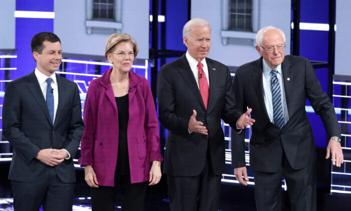 (L-R) South Bend Mayor Pete Buttigieg, Sen. Elizabeth Warren (D-Mass.), former Vice President Joe Biden, and Sen. Bernie Sanders (I-Vt.) at the start of the Democratic Presidential Debate at Tyler Perry Studios in Atlanta, Georgia, on Nov. 20, 2019. (Alex Wong/Getty Images)