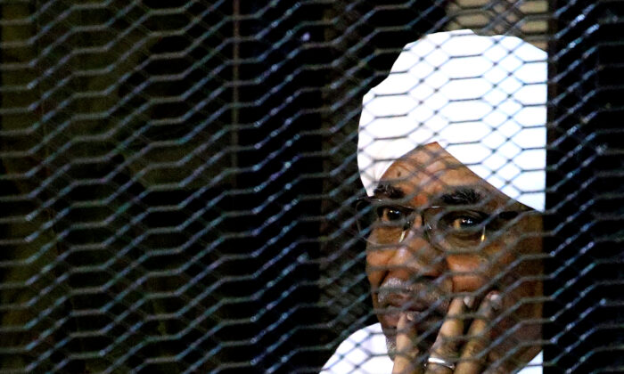Sudan's former president Omar Hassan al-Bashir sits inside a cage at the courthouse where he is facing corruption charges, in Khartoum, Sudan, on Sept. 28, 2019. (Mohamed Nureldin Abdallah/FIle Photo/Reuters)