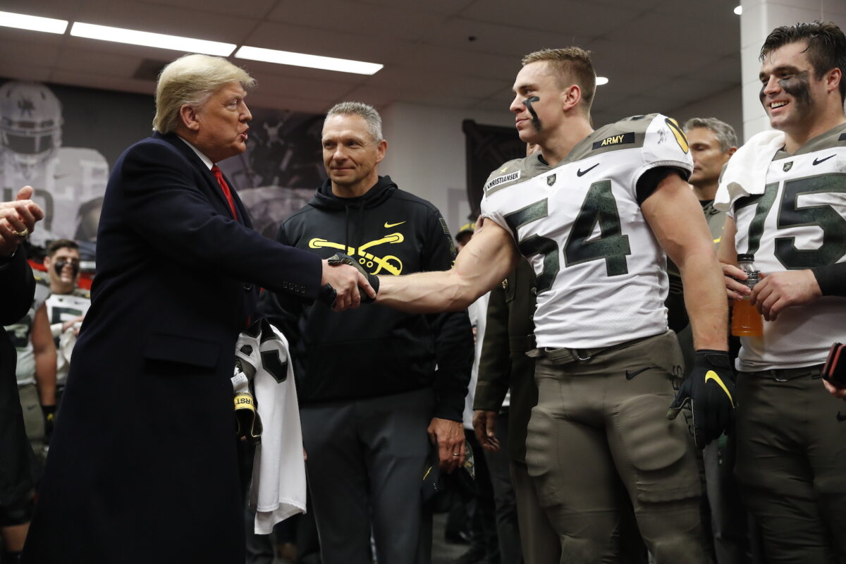 President Donald Trump shakes hands with Army player Cole Christiansen