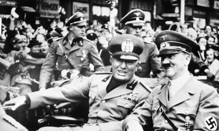 Italian dictator and National Fascist Party leader Benito Mussolini (L) rides in a car with Nazi leader Adolf Hitler in Munich, Germany, on Sept. 28, 1938. (AP Photo/File)