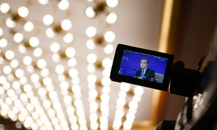 A camera monitor shows China's Foreign Minister Wang Yi answering a question during a National People's Congress press conference in Beijing on March 8, 2019. (WANG ZHAO/AFP via Getty Images)