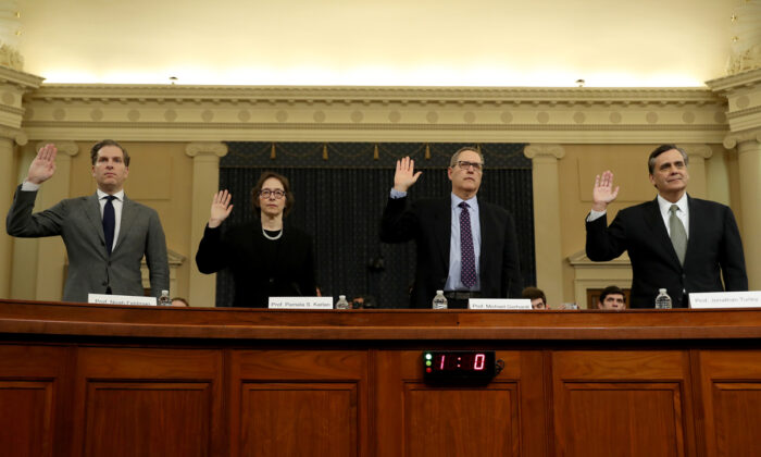Constitutional scholars Noah Feldman of Harvard University, Pamela Karlan of Stanford University, Michael Gerhardt of the University of North Carolina, and Jonathan Turley of George Washington University are sworn in to testify before the House Judiciary Committee in the Longworth House Office Building on Capitol Hill on Dec. 4, 2019. Chip Somodevilla/Getty Images