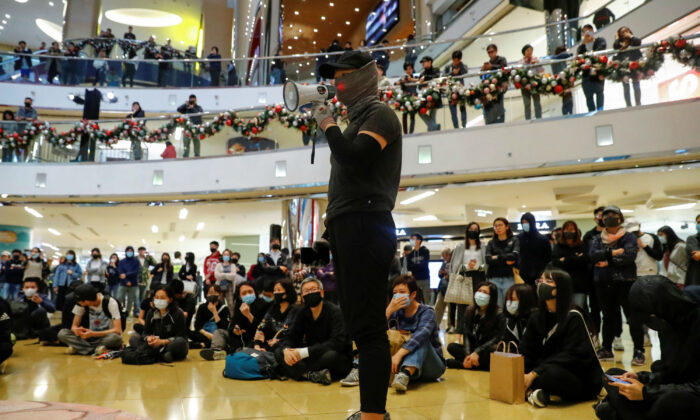 A protester delivers a speech during a demonstration inside a shopping mall in Taikoo, in Hong Kong, China Dec. 15, 2019. (Reuters/Thomas Peter)
