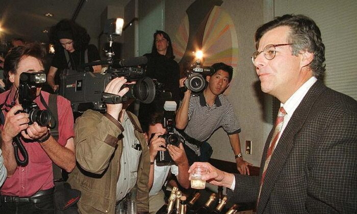 Myron Scholes, Professor of Finance, Emeritus, at Stanford Graduate School of Business, poses for photographers in Palo Alto, California, on 14 October 1997 during a press conference he gave upon learning that he has won the Nobel Prize in Economics. Scholes shared the prize with Robert C. Merton of the US, a professor at Harvard University. (John G. Mabanglo/AFP/Getty Images)