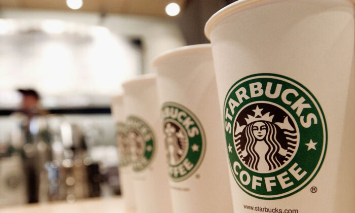 Beverage cups featuring the logo of Starbucks Coffee. (Stephen Chernin/Getty Images)