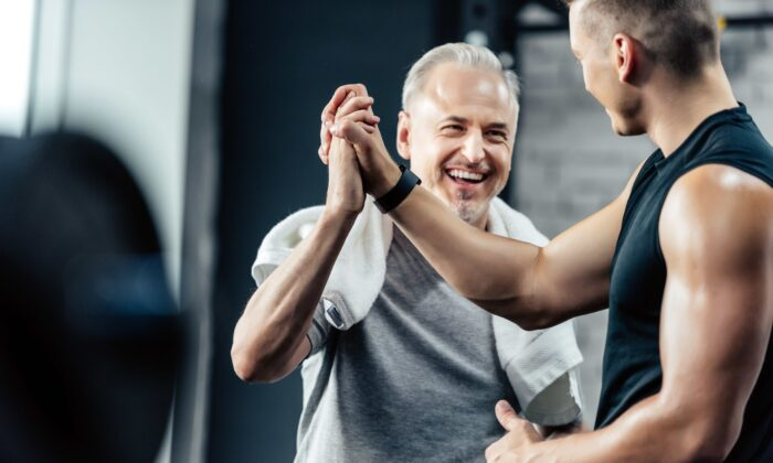 Keep exercise interesting, an exercise buddy or trainer can help, to keep you committed. (LightField Studios/Shutterstock)