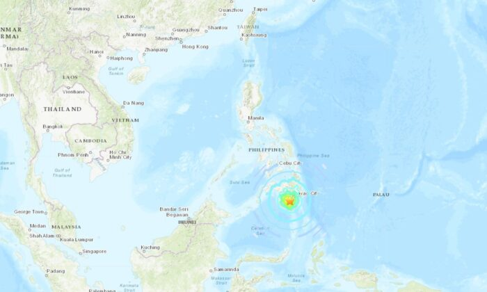 A powerful magnitude 6.9 earthquake in the southern Philippines killed three people and triggered the collapse of a three-story building, it was reported. (USGS)