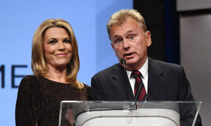 """""""Wheel of Fortune"""" hostess Vanna White (L) and host Pat Sajak in a file photo.  (Photo by Ethan Miller/Getty Images)"""