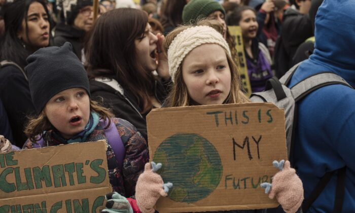 Schoolchildren take part in a climate-change protest in Edmonton on Sept. 27, 2019. We educate students when we help them think for themselves, but we indoctrinate them if we make them think like us. (The Canadian Press/Amber Bracken)