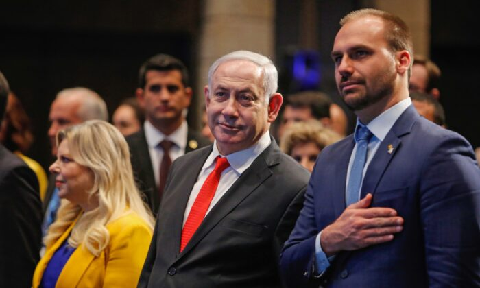 Israeli Prime Minister Benjamin Netanyahu attend with his wife Sara and Brazilian Federal Deputy Eduardo Bolsonaro (R) the opening ceremony of the Brazilian Ministry Trade And Investment Promotion Agency in Jerusalem on Dec. 15, 2019. (GIL COHEN-MAGEN/AFP via Getty Images)