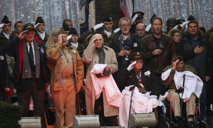 U.S. Battle of the Bulge veterans, front row, listen to the U.S. national anthem during a ceremony to commemorate the 75th anniversary of the Battle of the Bulge at the Mardasson Memorial in Bastogne, Belgium, on Monday, Dec. 16, 2019. (Francisco Seco/AP)