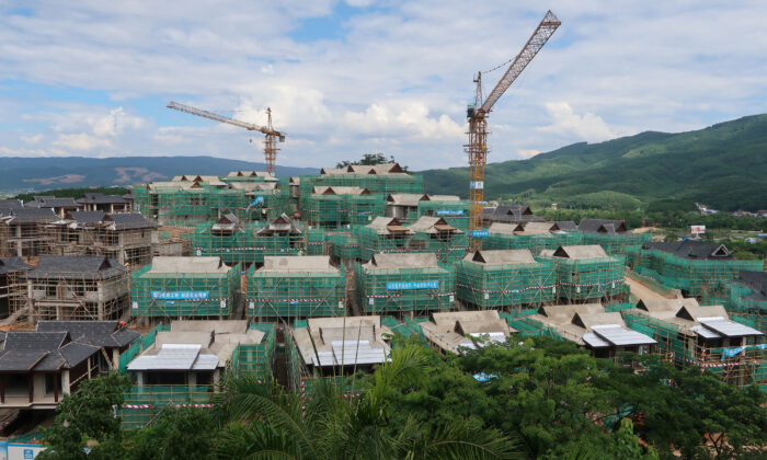 """Villas of real estate property """"Viva Villa"""" developed by Ping An Real Estate are seen under construction in Xishuangbanna Dai Autonomous Prefecture, Yunnan Province, China on June 20, 2019. (Lusha Zhang/Reuters)"""