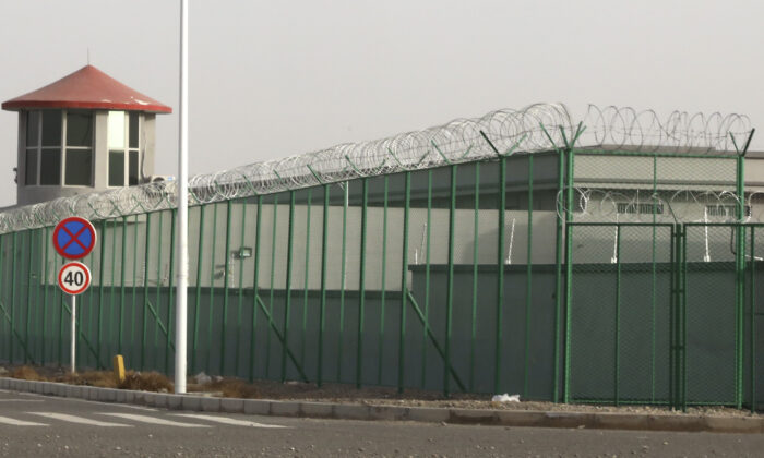 A guard tower and barbed wire fences are seen around a facility in the Kunshan Industrial Park in Artux in western China's Xinjiang region on Dec. 3, 2018. People in touch with state employees in China say the government in the far west region of Xinjiang is destroying documents and taking other steps to tighten control on information. (Ng Han Guan/AP Photo)