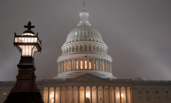 The U.S. Capitol in Washington is shrouded in mist, on the night of Dec. 13, 2019. (J. Scott Applewhite/AP Photo)