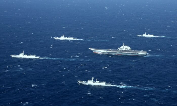 This aerial photo taken on January 2, 2017 shows a Chinese navy formation, including the aircraft carrier Liaoning (C), during military drills in the South China Sea. (STR/AFP via Getty Images)