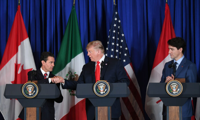 (L to R) Mexican President Enrique Pena Nieto, U.S. President Donald Trump, and Canadian Prime Minister Justin Trudeau deliver a statement on the signing of a new free trade agreement in Buenos Aires, on the sidelines of the G20 Leaders' Summit, on Nov. 30, 2018. (MARTIN BERNETTI/AFP via Getty Images)