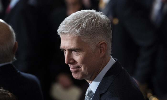 U.S. Supreme Court Associate Justice Neil M. Gorsuch waits for the arrival of former U.S. President George H.W. Bush at the U.S. Capitol in Washington on Dec. 03, 2018. (Jabin Botsford - Pool/Getty Images)