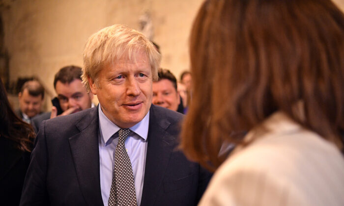 British Prime Minister Boris Johnson greets newly-elected Conservative MPs at the Houses of Parliament, London, Britain on Dec. 16, 2019. (Leon Neal/Pool via Reuters)