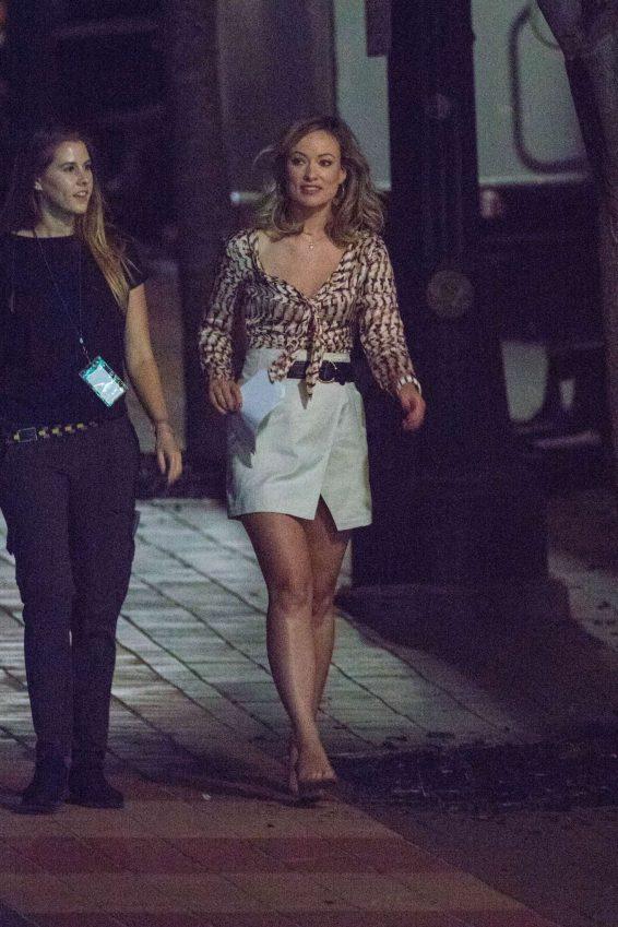 Two women walking on sidewalk