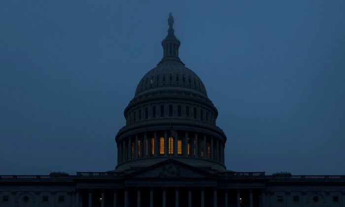 The U.S. Capitol dome is shrouded in early-morning mist on another day of continued impeachment inquiry hearings into U.S. President Donald Trump's dealings with Ukraine, in Washington. Dec. 9, 2019. (Jonathan Ernst/Reuters/File)