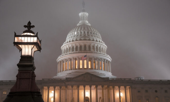 The U.S. Capitol in Washington is shrouded in mist on Dec. 13, 2019. (J. Scott Applewhite/AP Photo)