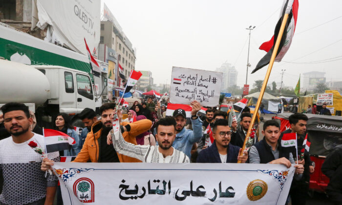 Iraqi protesters march during a anti-government protest in Tahrir square in the capital Baghdad, on Dec. 15, 2019.(Sabah Arar/AFP via Getty Images)