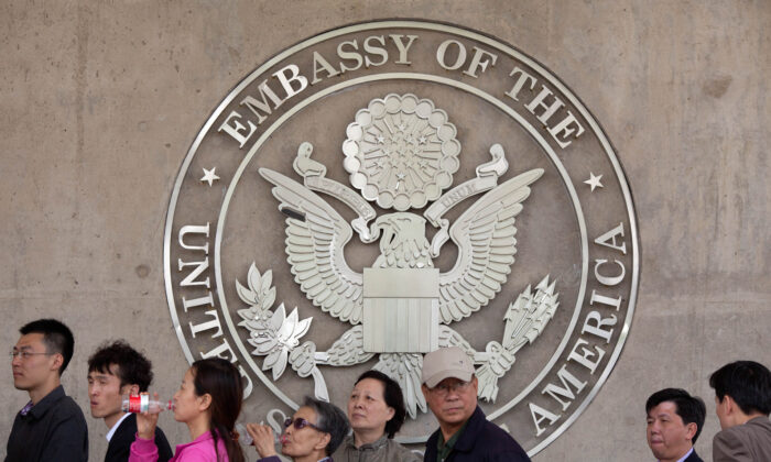People queue outside the US embassy in Beijing, China, on April 27, 2012. (Ed Jones/AFP/GettyImages)
