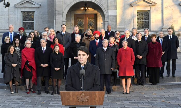 Prime Minister Justin Trudeau speaks as Liberal cabinet ministers look on following the swearing-in of the new cabinet at Rideau Hall in Ottawa on Nov. 20, 2019. (The Canadian Press/Adrian Wyld)