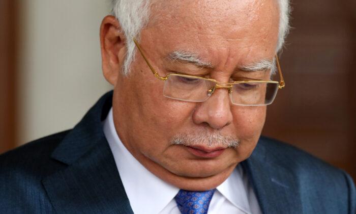Former Malaysia's Prime Minister Najib Razak leaves Kuala Lumpur High Court in Kuala Lumpur, Malaysia, on July 15, 2019. (Lim Huey Teng/Reuters)