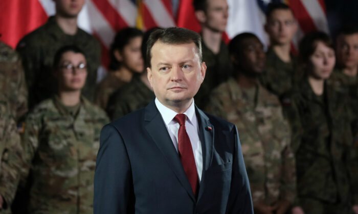 Mariusz Blaszczak, National Defense Minister of Poland, stands near U.S. soldiers during the visit of U.S. Vice President Mike Pence at a military base on February 13, 2019 in Warsaw, Poland. ( Sean Gallup/Getty Images)