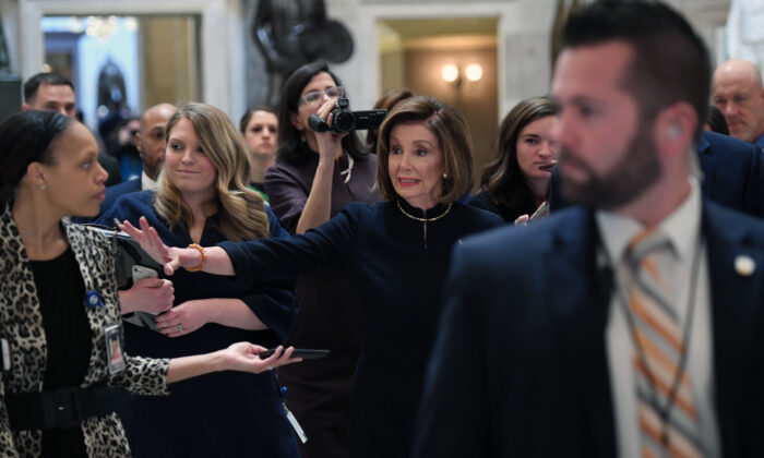 House Speaker Nancy Pelosi (D-Calif.) walks to the House floor at the US Capitol, while the House readies for a historic vote on December 18, 2019. (SAUL LOEB/AFP via Getty Images)