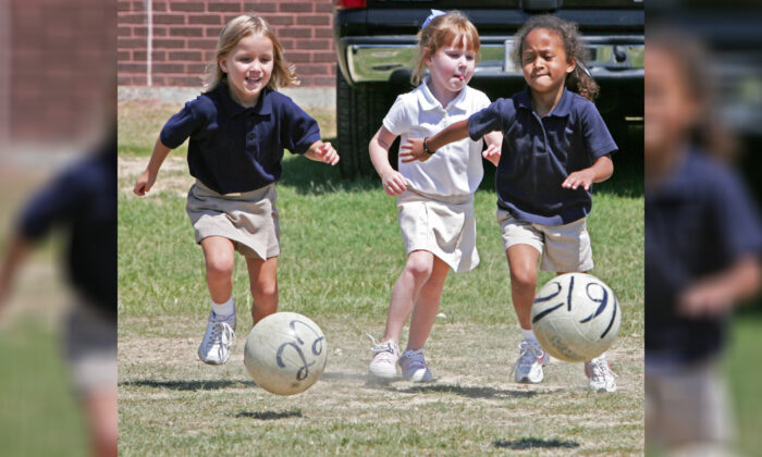 Children play with soccer balls at Northwestern Elementary School in Zachary, La. on Sept. 7, 2005. (Paul J. Richards/AFP via Getty Images)
