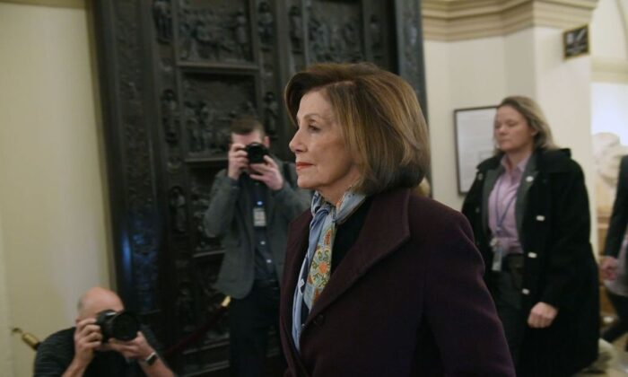 Speaker of the House Nancy Pelosi (D-Calif.) arrives at the U.S.Capitol, as the House readies for a historic vote in Washington on Dec. 18, 2019.  (Saul Loeb/AFP)