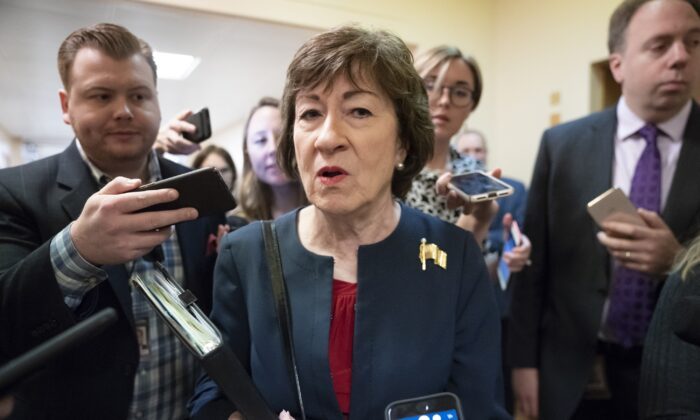 Sen. Susan Collins (R-Maine) is surrounded by reporters as she heads to vote at the Capitol in Washington on Nov. 6, 2019. (J. Scott Applewhite/AP Photo)