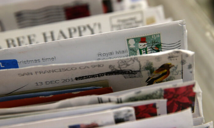 Holiday stamps are seen on mail at the U.S. Post Office sort center in San Francisco, California, on Dec. 18, 2014. (Justin Sullivan/Getty Images)
